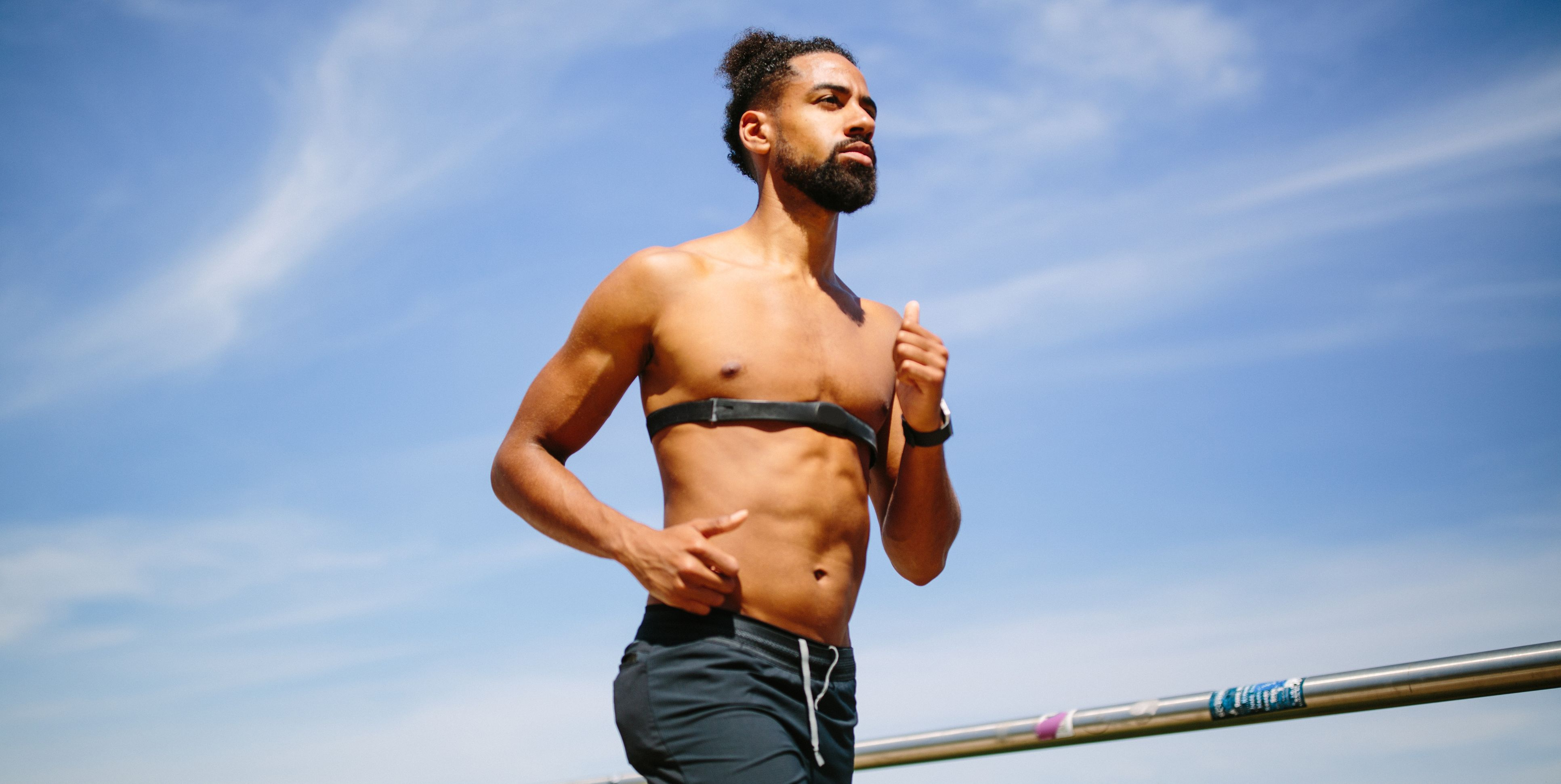 Man running with heart rate monitor