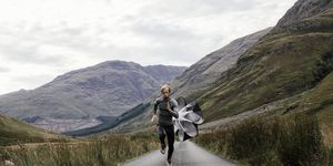 Man running with speed chute Scottish highlands