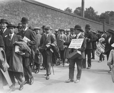 vintage photos   a man hands out souvenirs at a sporting event
