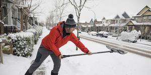 Man shoveling snow in winter