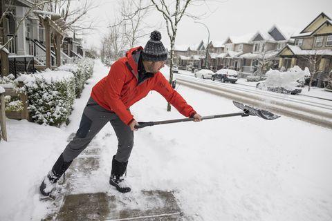 Man shoveling snow in winter