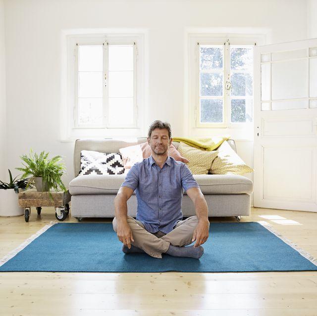 Man sitting on ground, meditating