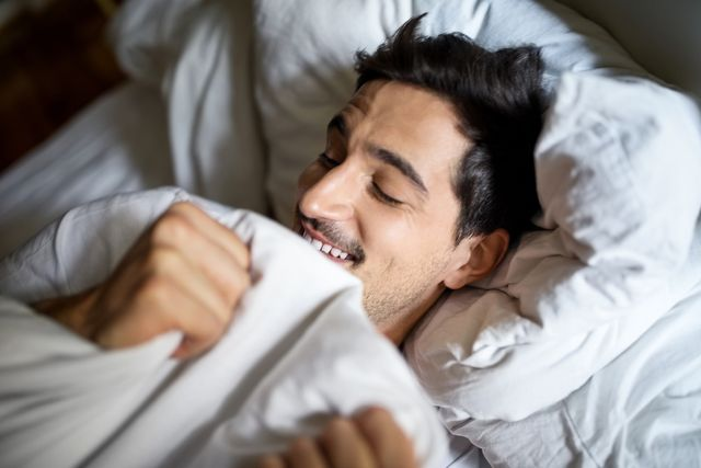man sleeping comfortably in bed