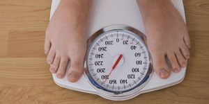 Man standing on weighing scales