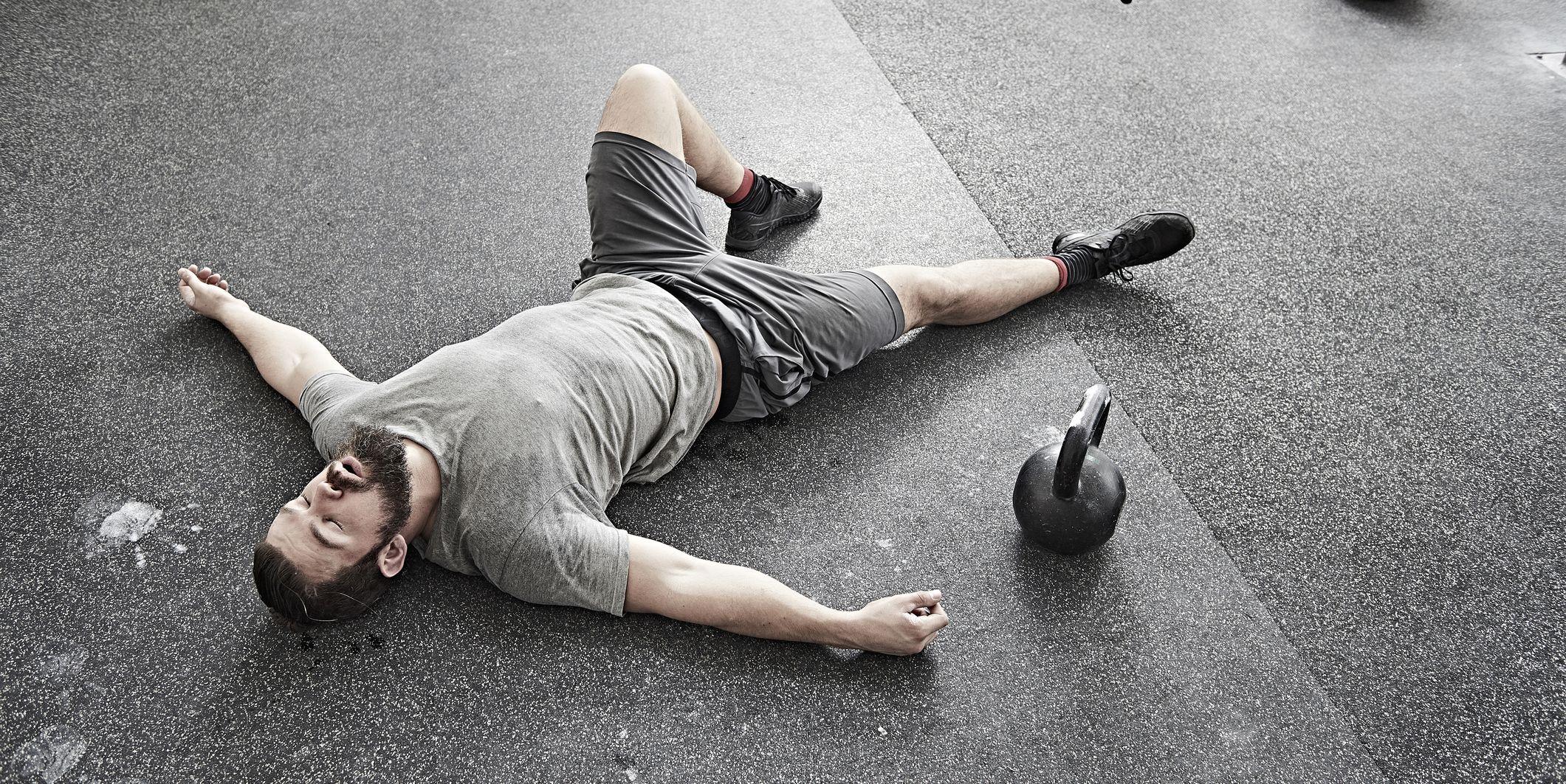 Man taking break in cross training gym