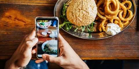 Man Talking Picture Of Burger With Smartphone