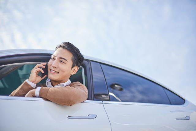 a man talking through a phone while driving