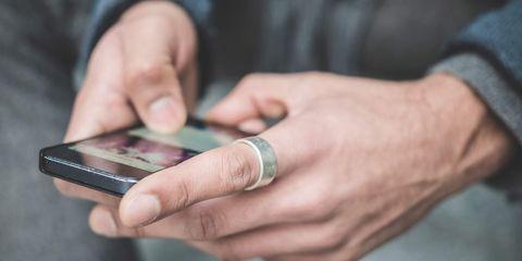man texting, man sending text message,