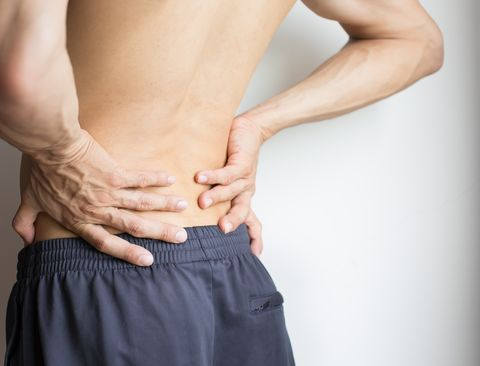 Man touching his back because of severe back pain