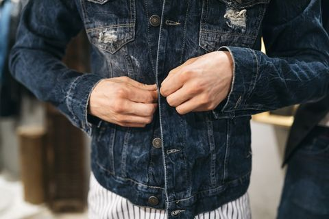 Man trying on new denim jacket