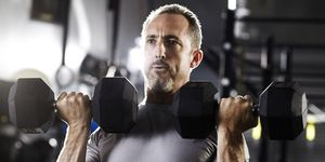 Man using dumbbells in a gym