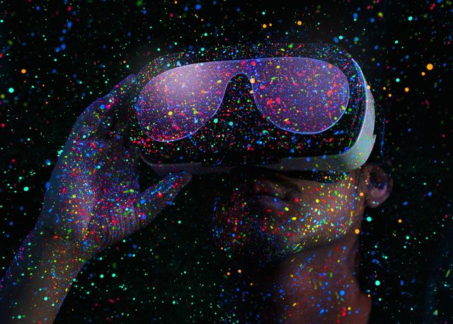 man using virtual reality headset with black light