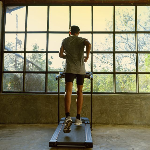 a man walking and exercising on a treadmill