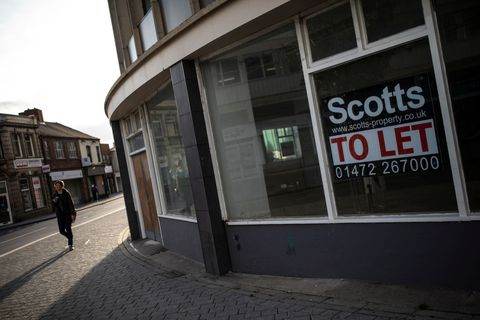 A man walks past a vacant high street shop on October 8, 2018 in Grimsby, England
