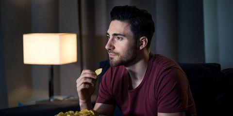 man watching movie at home