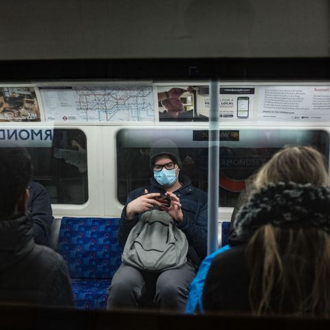 A man wearing a face mask seen in a tube.   The UK government...