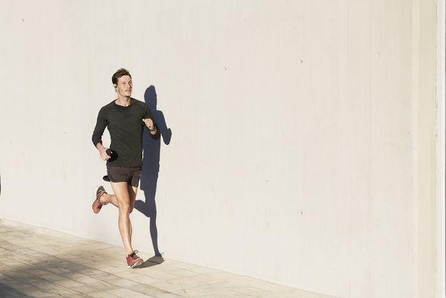 man wearing sportswear jogging