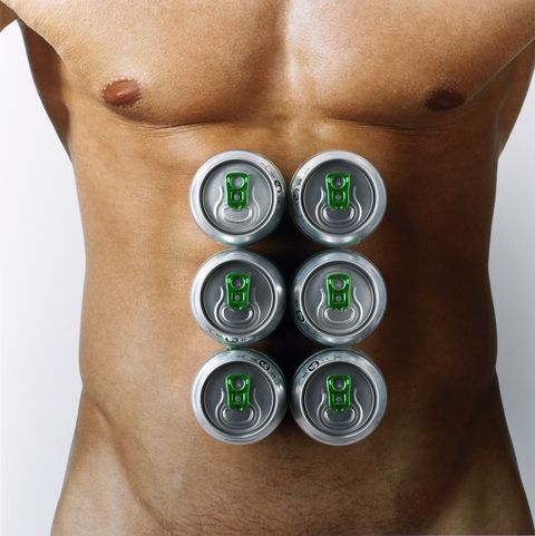 Man with beer cans on chest, mid section