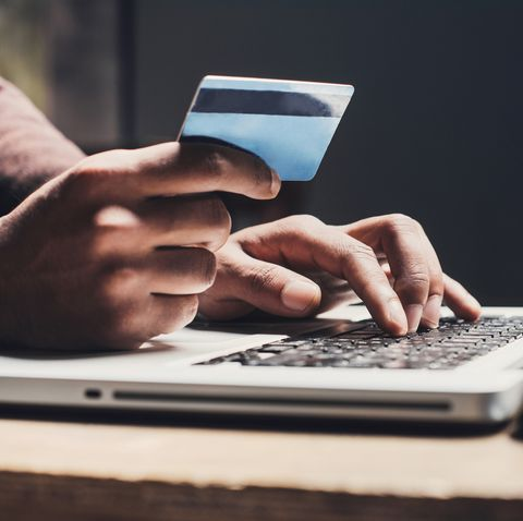 Man on computer with credit card