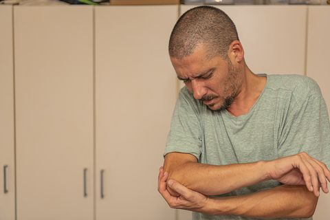 Man with Pain in Elbow