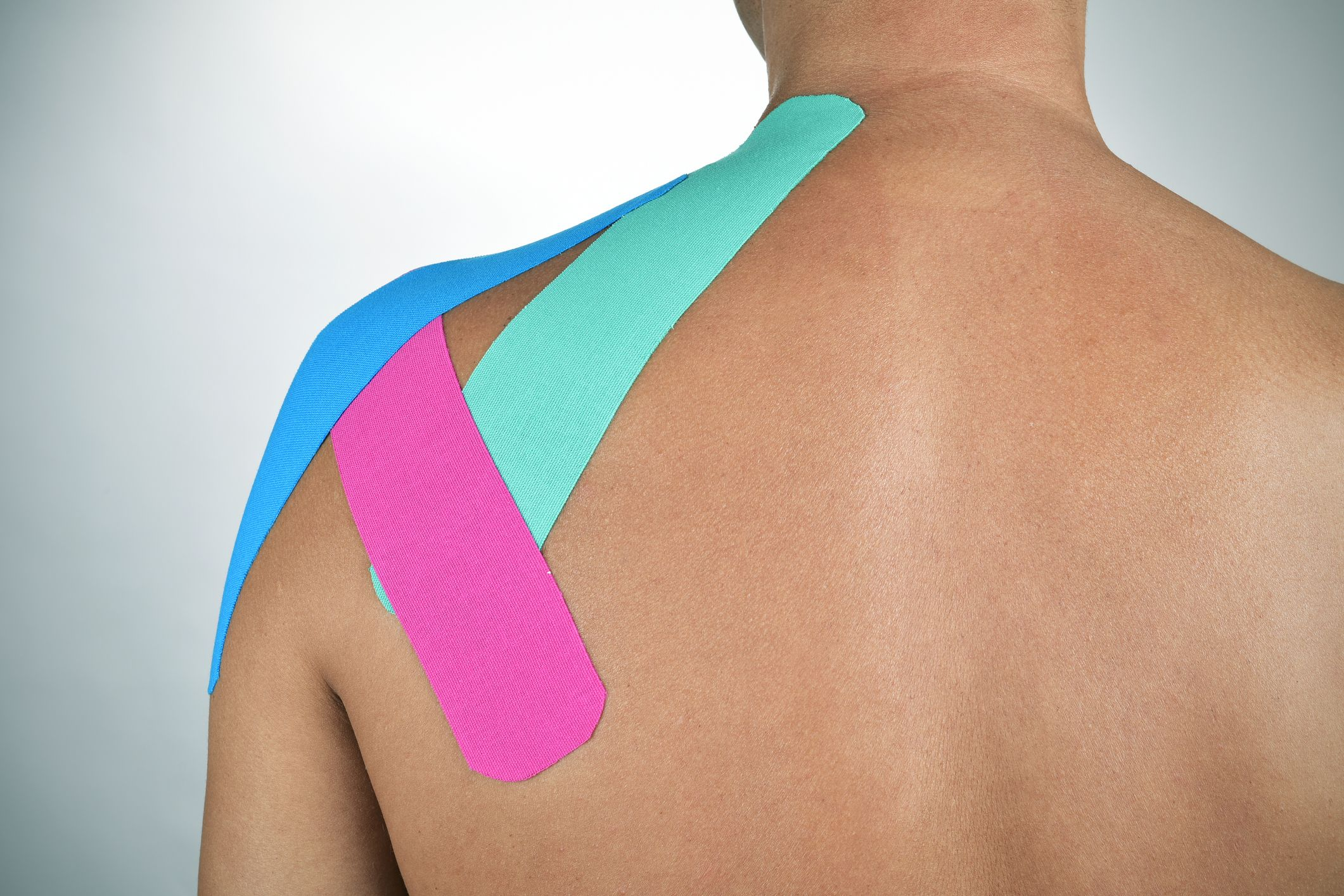 man with strips of elastic therapeutic tape in his ba