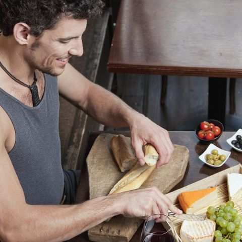 Man with wine, chees and grapes in tavern