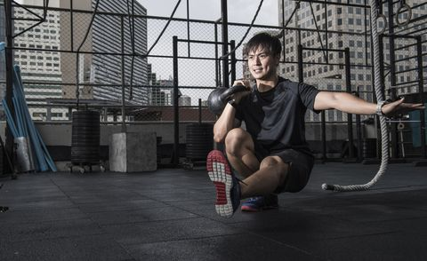 Man working out in rooftop gym, Asok, Bangkok, Thailand