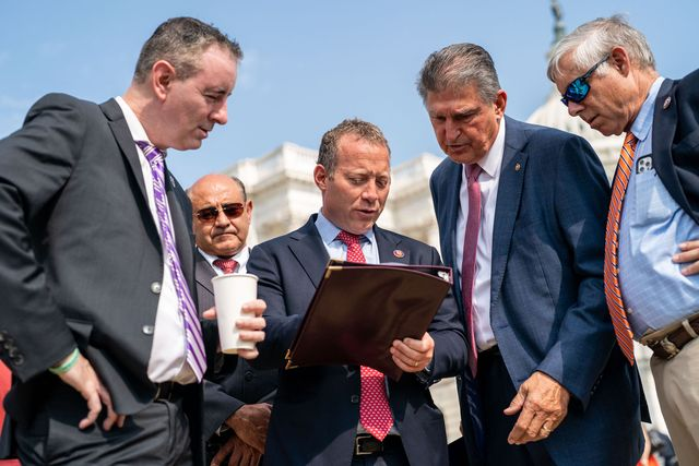 washington, dc   july 30 rep brian fitzpatrick r pa, rep josh gottheimer d nj, sen joe manchin d wv, and rep fred upton r mi talk before the problem solvers caucus news conference on the infrastructure deal at the house triangle in front of the us capitol building on friday, july 30, 2021 in washington, dc kent nishimura  los angeles times via getty images