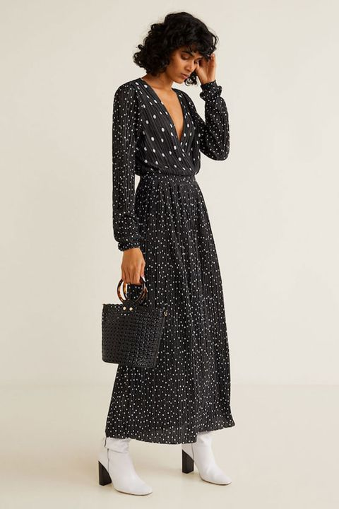 371024703bf 2of31. Black wedding guest dresses. Polka dot pleated dress, £69.99, Mango