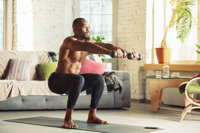 african american man teaching at home online courses of fitness, aerobic, sporty lifestyle while being quarantine getting active while isolated, wellness, movement concept training with weights