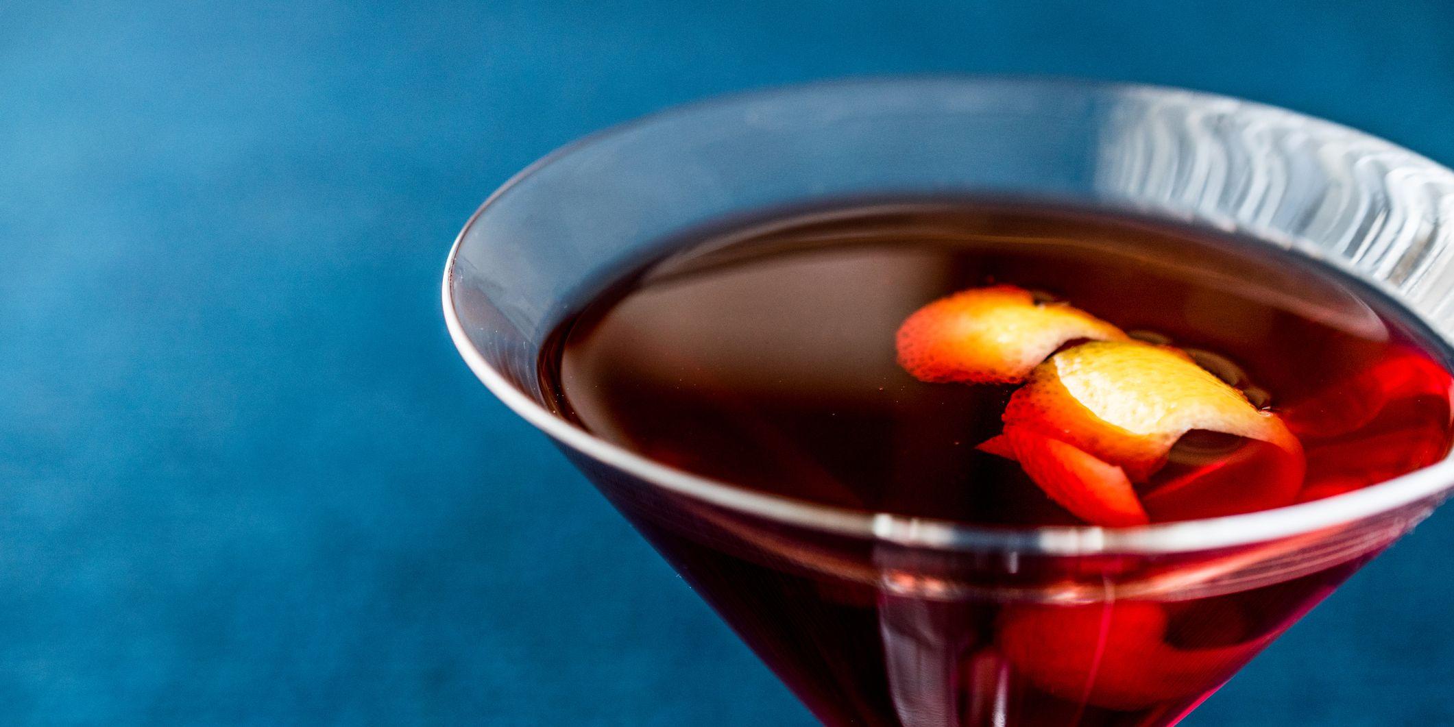Manhattan Cocktail with orange peel.