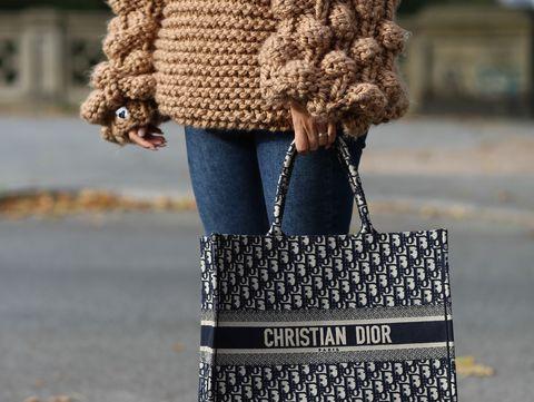 Street fashion, Clothing, Fashion, Bag, Brown, Jeans, Handbag, Fur, Fashion accessory, Outerwear,