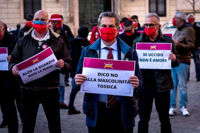 rome, italy   march 04 men take part in a flash mob to demonstrate against male violence against women wearing a red mask on march 4, 2021 in rome, italy men from liberare roma protested against the increase of violence against women since the pandemic and successive lockdowns, wearing red masks manufactured by women at the eva cooperative, which helps them build a path to autonomy after managing to escape violence photo by stefano montesi   corbiscorbis via getty images