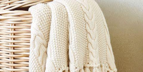 Clothing, Wool, Woolen, Outerwear, Beige, Textile, Knitting, Thread, Woven fabric, Shawl,