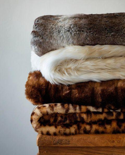 Fur, Fur clothing, Brown, Wool, Textile, Beige, Linens, Natural material,