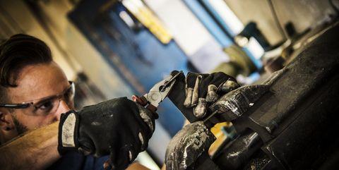 Manual worker in metal workshop