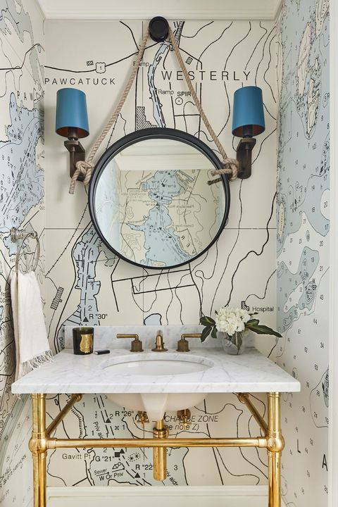 Small bathroom with map wallpaper and mirror
