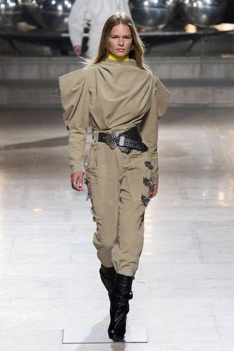 Fashion model, Fashion show, Runway, Fashion, Clothing, Shoulder, Joint, Human, Public event, Outerwear,