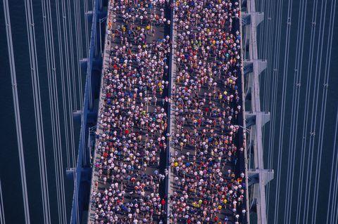Marathon runners jogging across bridge, elevated view
