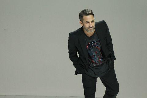 Sleeve, Shoulder, Collar, Coat, Standing, Outerwear, Style, Pocket, Formal wear, Beard,