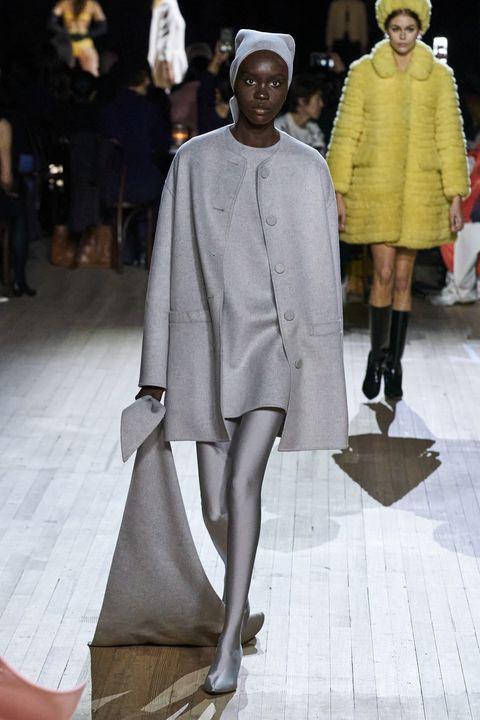 Fashion, Fashion model, Runway, Clothing, Fashion show, Outerwear, Human, Footwear, Fashion design, Event,