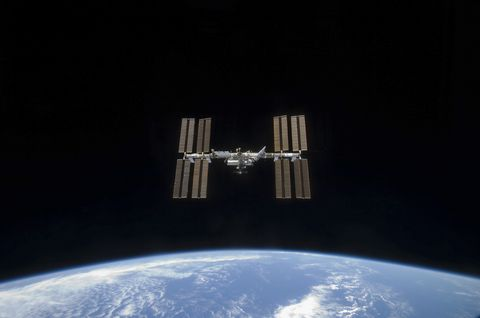 March 25, 2009 - The International Space Station, backdropped by the blackness of space and Earth's horizon.