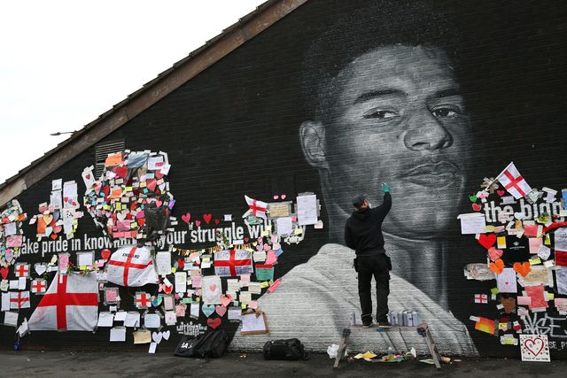 manchester, england   july 13  a defaced mural of marcus rashford is repaired by the artist akse p19 on july 13, 2021 in manchester, england rashford and other black players on england's national football team have been the target of racist abuse, largely on social media, after the team's loss to italy in the uefa european football championship last night england manager gareth southgate, prime minister boris johnson, and the football association have issued statements condemning the abuse photo by alex livesey   danehousegetty images