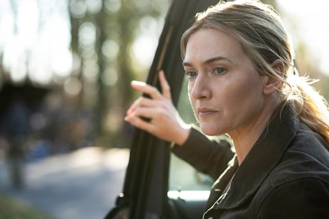 kate winslet climbing out of a car in mare of easttown