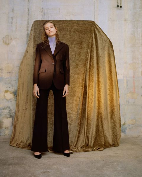 Clothing, Outerwear, Formal wear, Suit, Overcoat, Mantle, Costume, Coat, Fashion design,