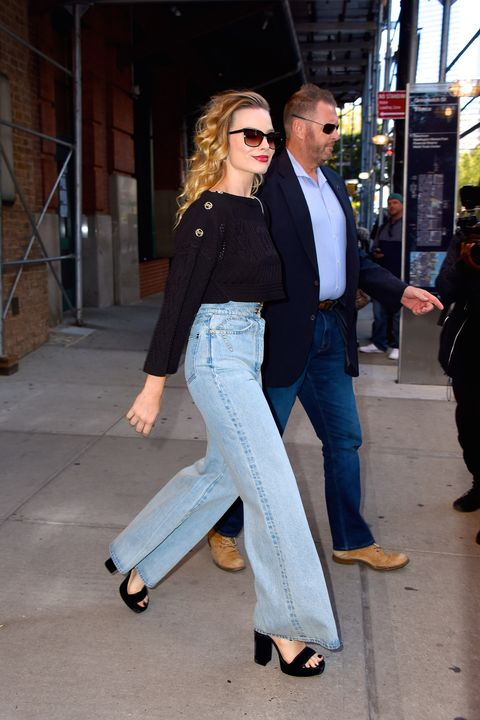 margot robbie, flared jeans, getty