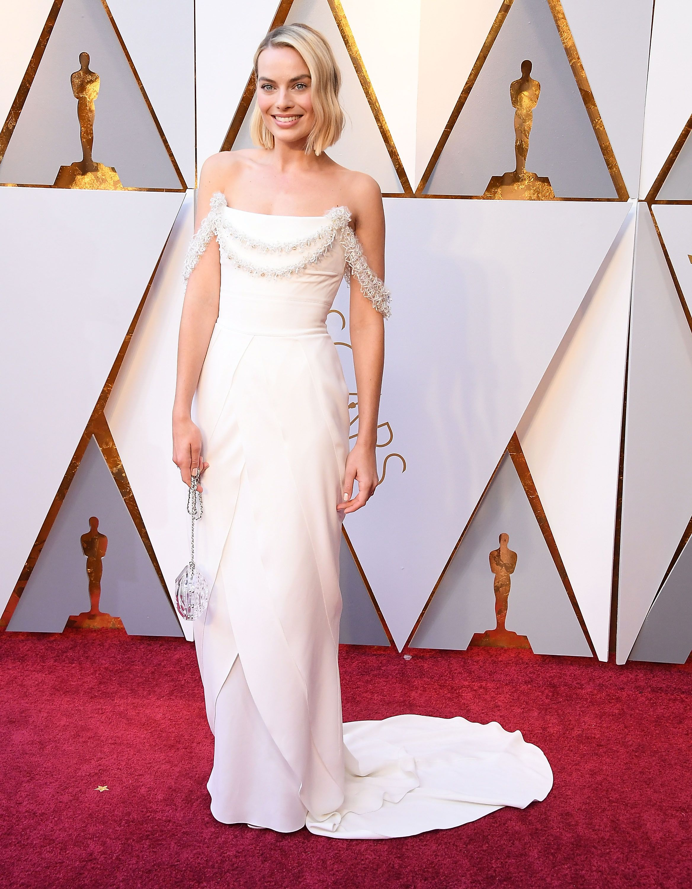 Margot Robbie, 2018 Margot Robbie looked like an angel in this white Chanel gown, which she wore when she was nominated for her role in I, Tonya .