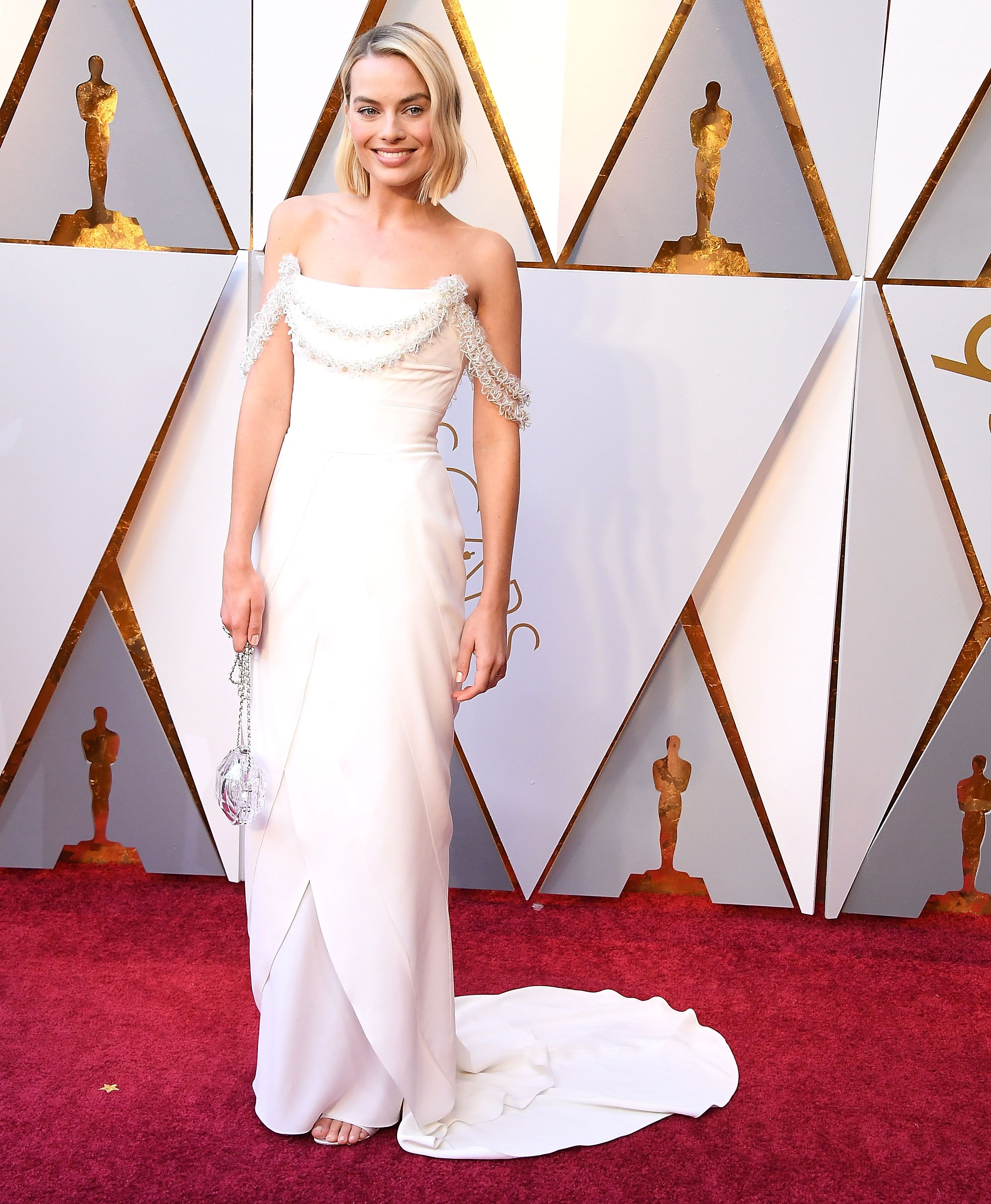 The Oscar-nominee wore feminine custome Chanel with delicate detailing at the bodice to the 90th Academy Awards.