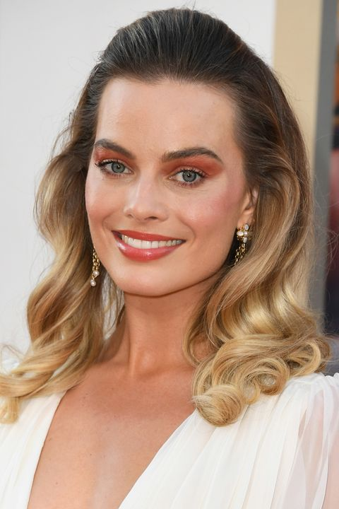 Margot Robbie demonstrates why burnt orange eye make-up is a big summer trend