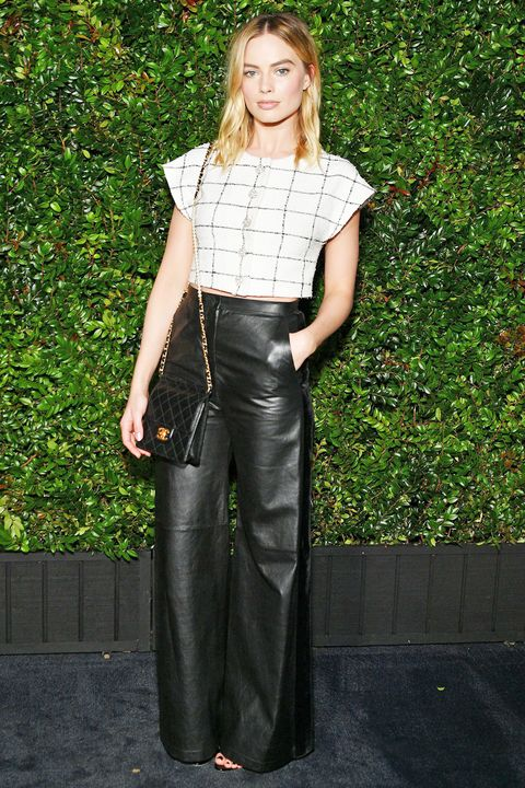 Margot Robbie wearing wide leg trousers